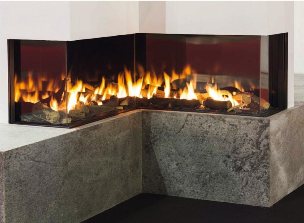 Camini moderni il fascino sensuale del fuoco tassonedil for Faber camini elettrici